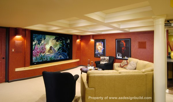 Multi-colored man cave with sectional sofa and huge flat screen TV