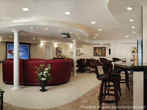 Elegant man cave design with round sofa, large screen TV, card table and mini-bar