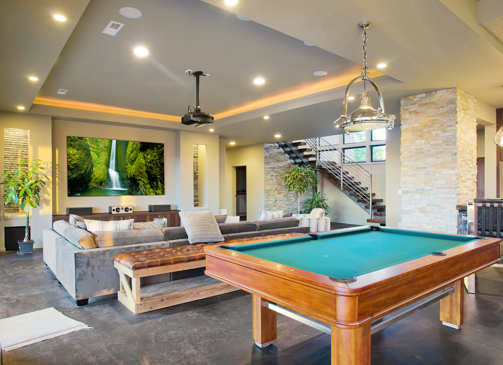 Large basement TV room with billiard table
