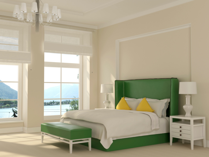 Lofty white and green bedroom with chandelier and large windows