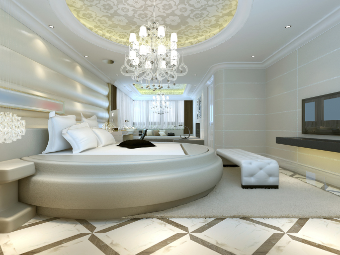 modern master bedroom luxuriously appointed with round bed in decor