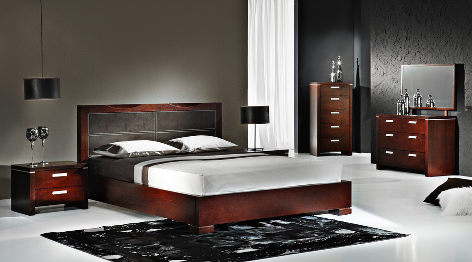 luxurious and modern bedroom with rich wood furniture black rug and white floor