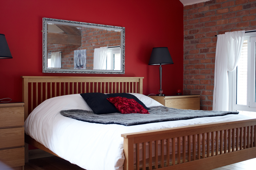 simple master bedroom. Simple Bedroom With Elevated Bed, Brick Wall And Red Master