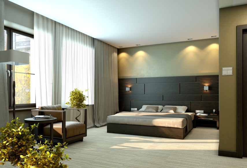 large modern bedroom with black and green design and separate sitting