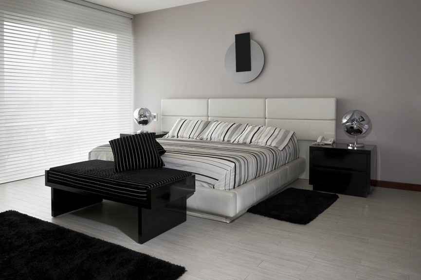 white and black bedroom with white floor white headboard and black furniture
