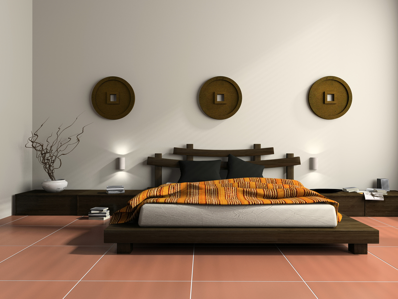 Simple Dark Wood Platform Bed On Red Tile Floor With White Walls