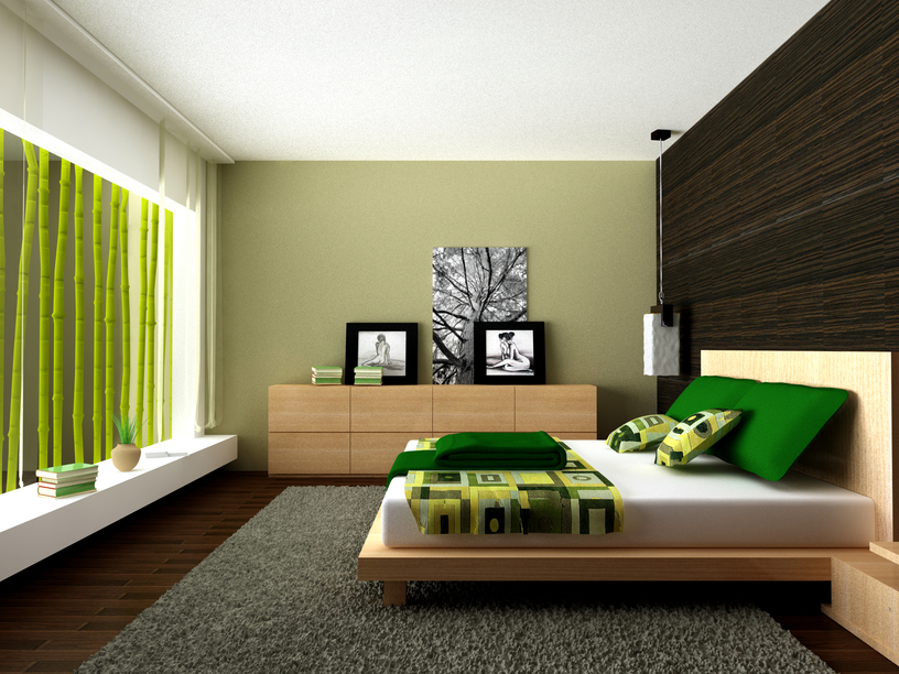 sleek low bed on large rug over dark wood floor with green color scheme - Modern Bedroom Decoration