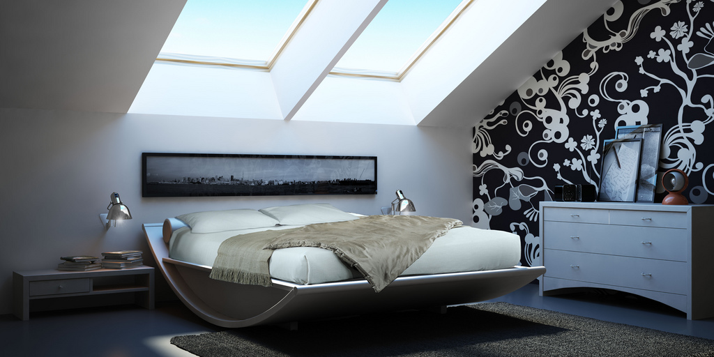 Master Bedroom In Attic With Skylights On A Rocking Bed With White, Black  And Grey