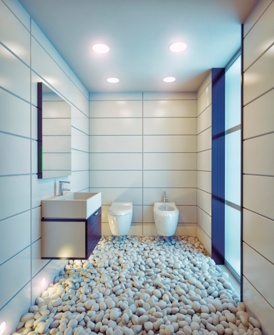 Funky bathroom design with pebble floor, floating sink and large white tile walls