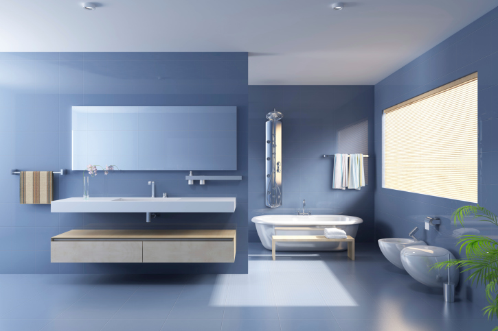 Cool blue-gray bath design with large floating sink and cabinet