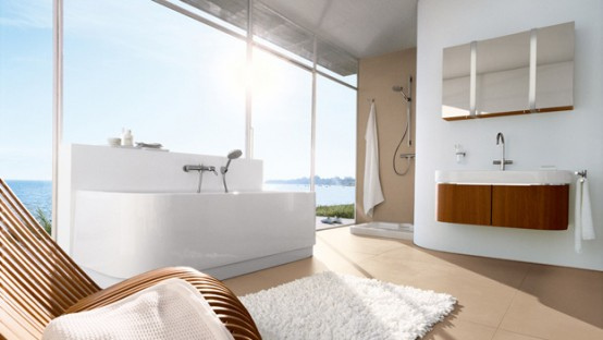 Large bright and airy modern bathroom with all-white tub next to floor-to-ceiling windows