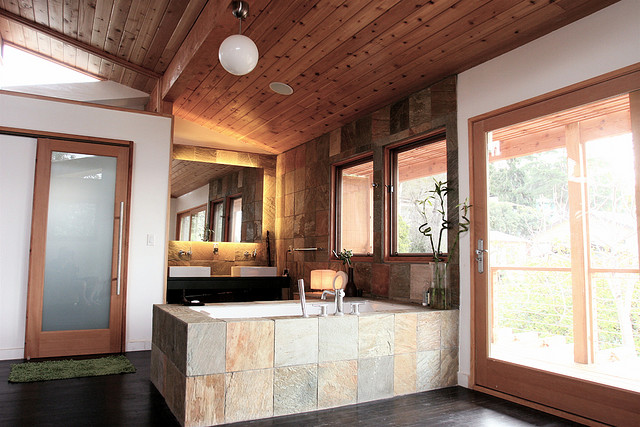 Large wood and tile bathroom design with large window