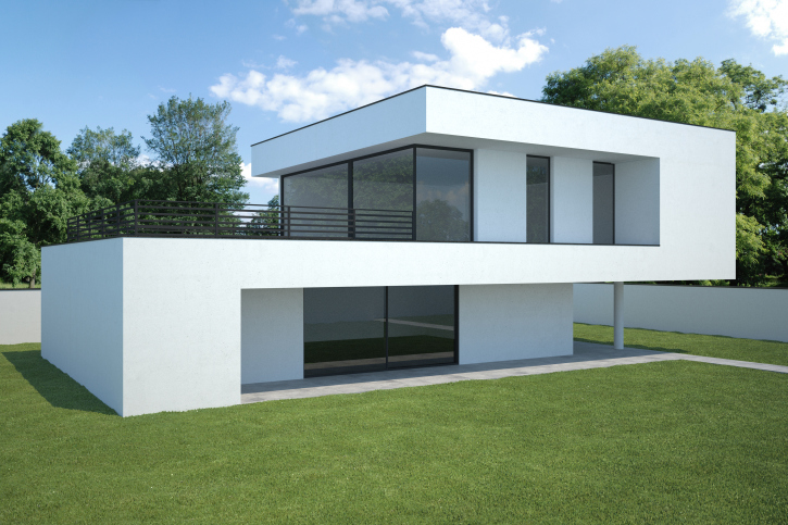 White geometric ultra modern home on large grass lot with trees in the background