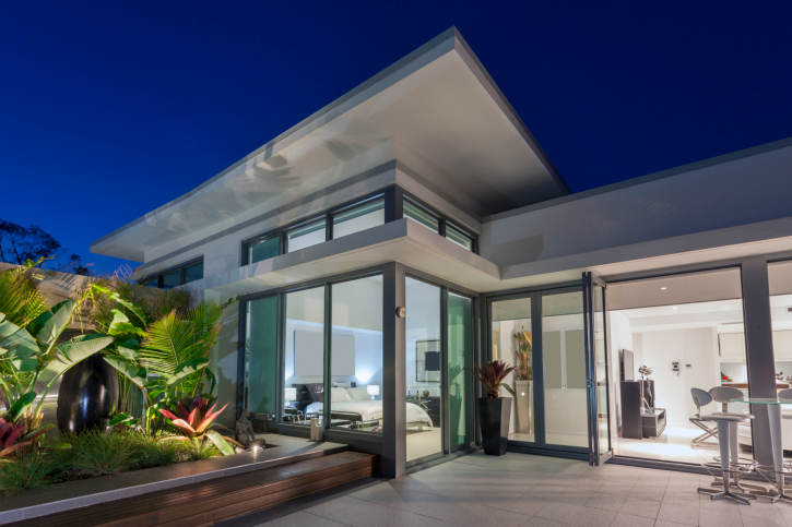 Large white modern home with floor-to-ceiling windows