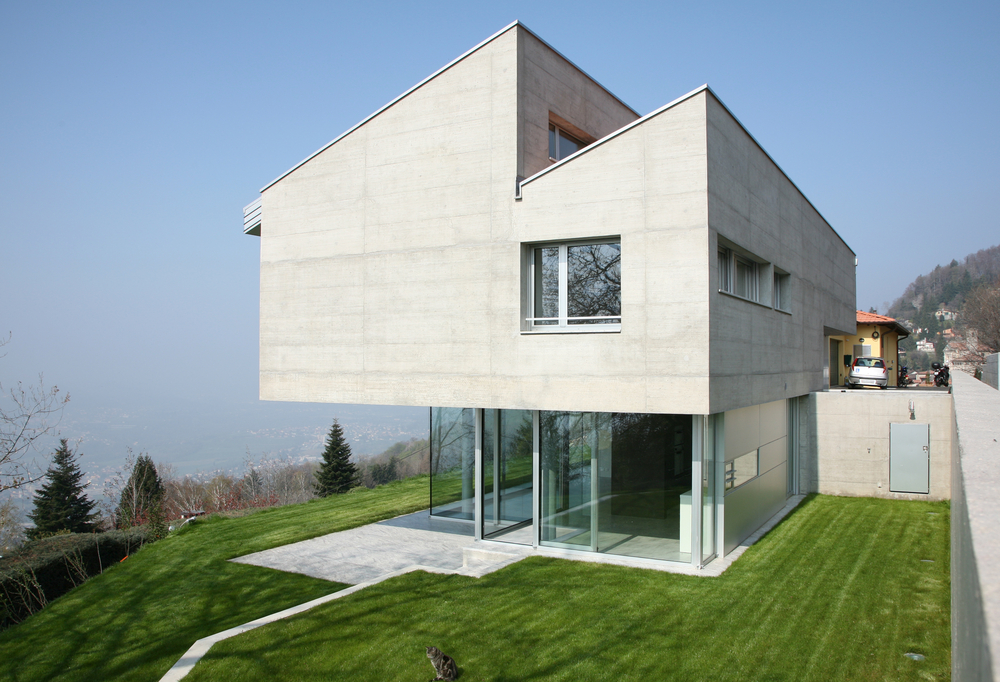 Good Top Heavy Geometric Concrete Home In Daylight