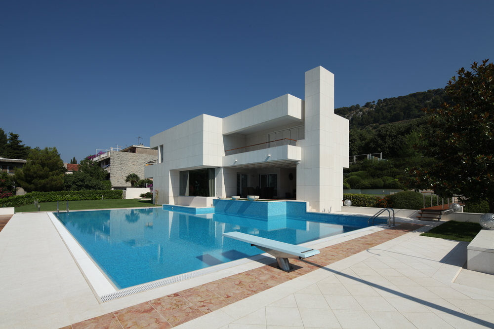 White Modern Home Built With Straight Lines With Large Backyard Pool