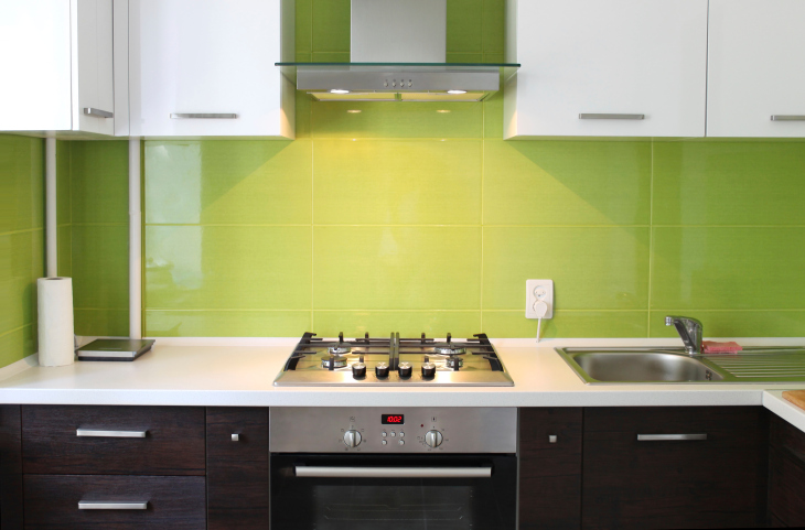 Small green black and white kitchen