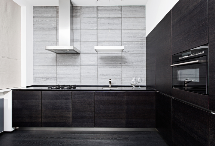 Dark black kitchen with black floor and black appliances