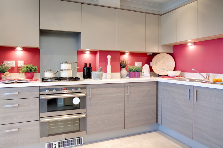 Stylish grey kitchen with red back splash