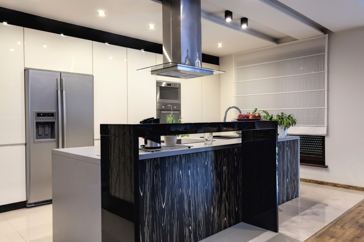 Ultra modern white and black kitchen with stainless steel appliances