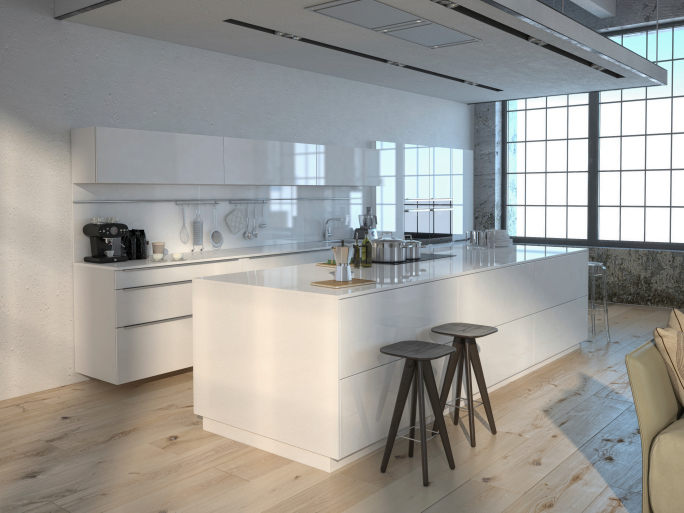 Large white kitchen with light natural wood floor and large window