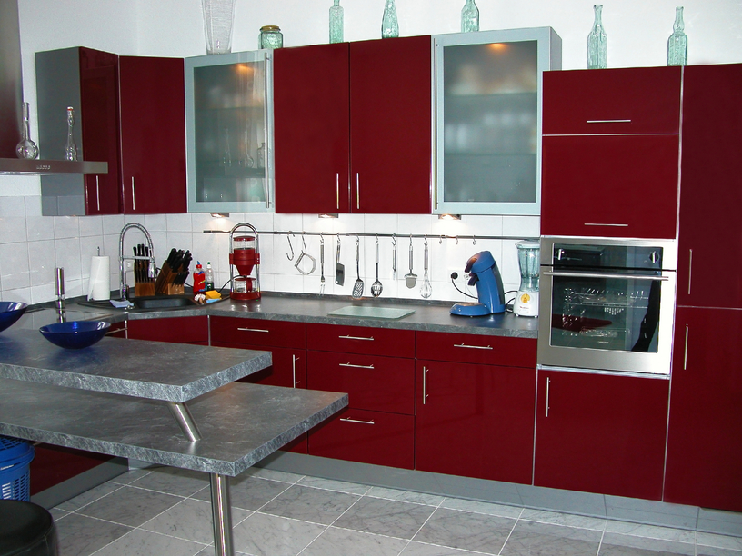 Deep red contemporary kitchen design idea with grey floor and island