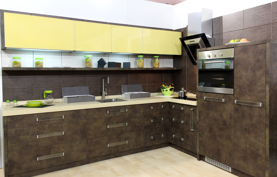 Elegant dark wood and yellow kitchen with light wood flooring