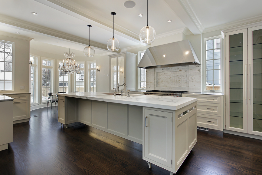 Expensive high-end white modern kitchen with dark hard wood floor