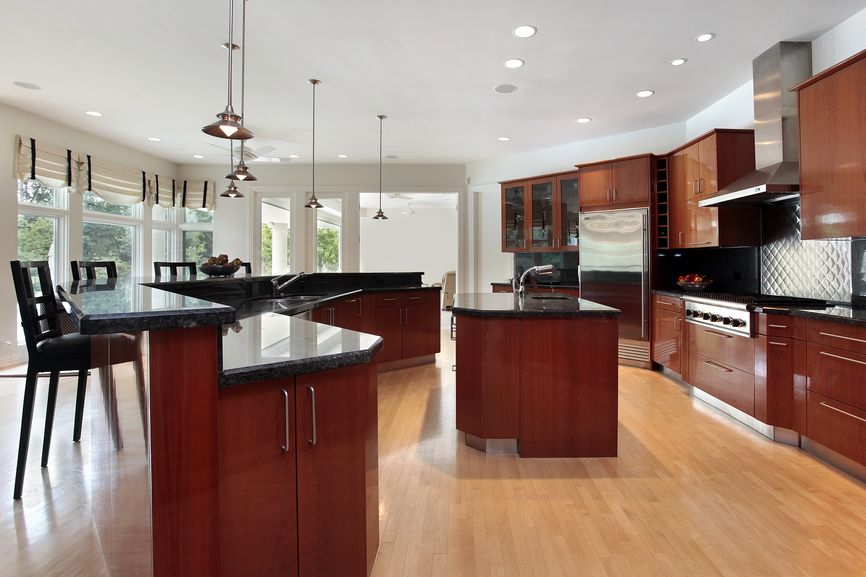Basic all-wood modern kitchen with black counter tops