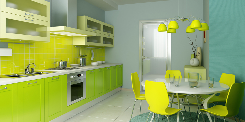 Funky light green modern kitchen with light yellow cabinets and small dining area