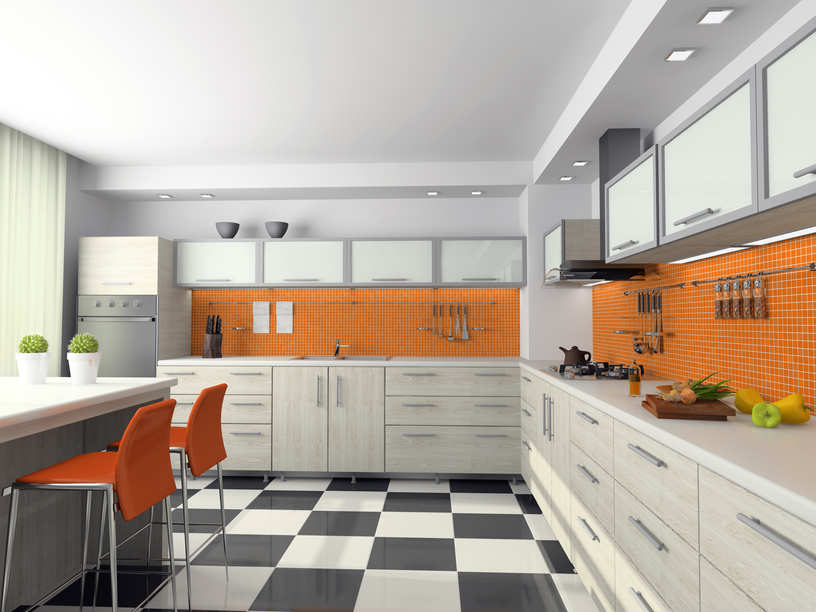 Orange and white kitchen with silver cabinets and checkered black and white floor