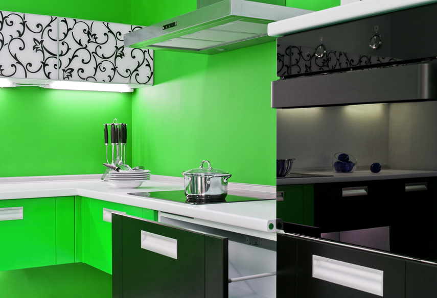 Bright green kitchen design with black appliances