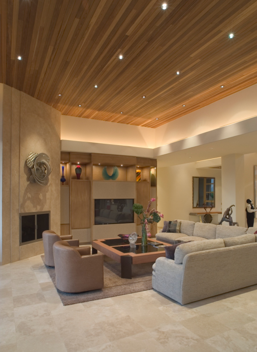 Large Living Room In Beige Color Scheme With Elevated Wood Ceiling.
