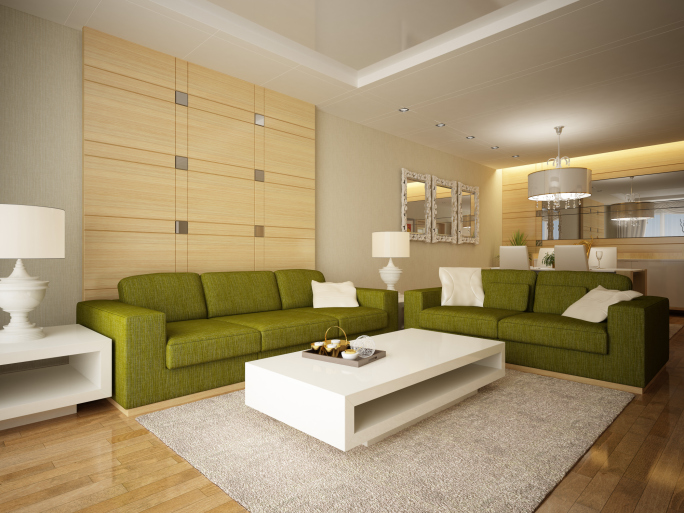 Bright Living Room With Green Sofas And White Modern Coffee Table