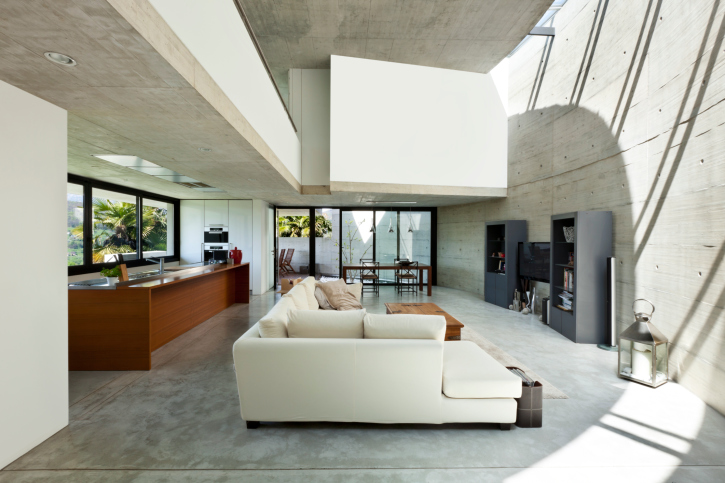Elegant Modern Concrete Living Room With Large White Sofa In Open Concept Design