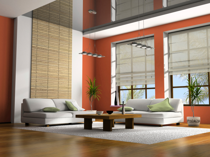 Vaulted ceiling living room with light wood floor, orange walls, white furniture and large white rug