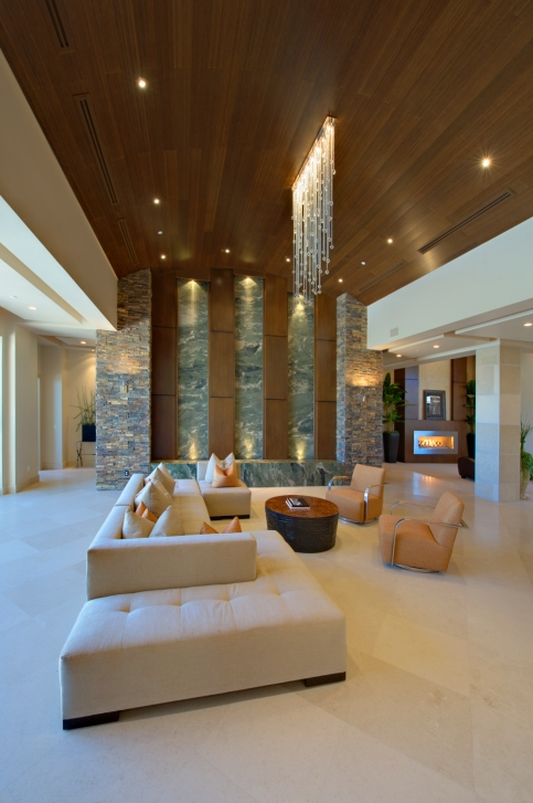 Enormous Living Room With Cathedral Wood Ceiling, Large White Sofa And Pot  Lighting