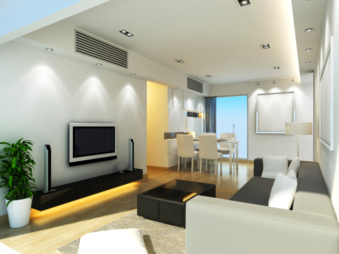 Small living room with grey furniture, small black coffee table and small flat screen TV