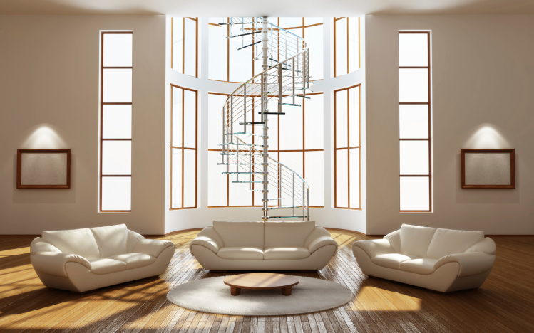 Huge living room with spiral staircase, cathedral ceiling, 3 white couches, glass coffee table and hard wood flooring