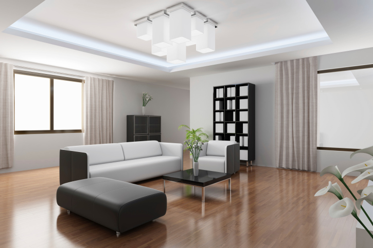 Minimalist Living Room Design With White And Black Furniture, Wood Floor  And Small Black Coffee