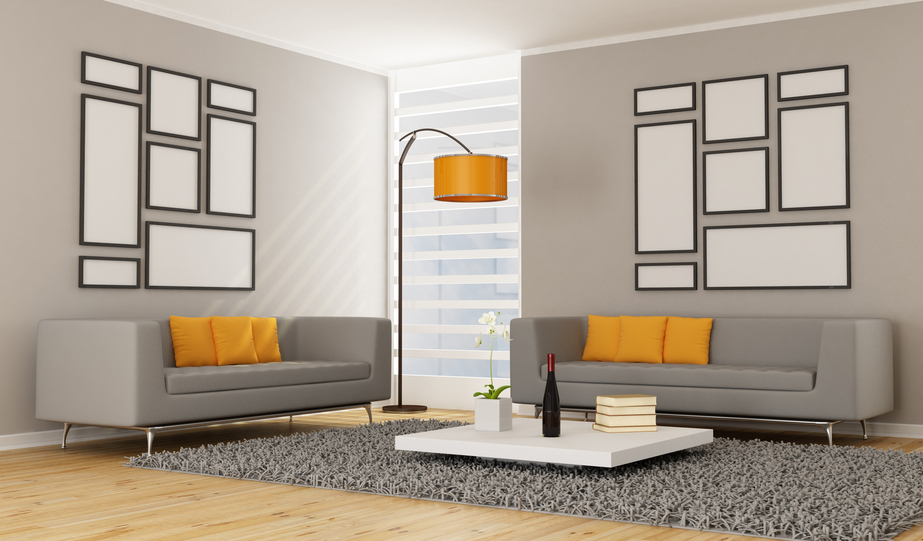 Minimalist Living Room With 2 Grey Sofas Orange Pillows Lamp Rug