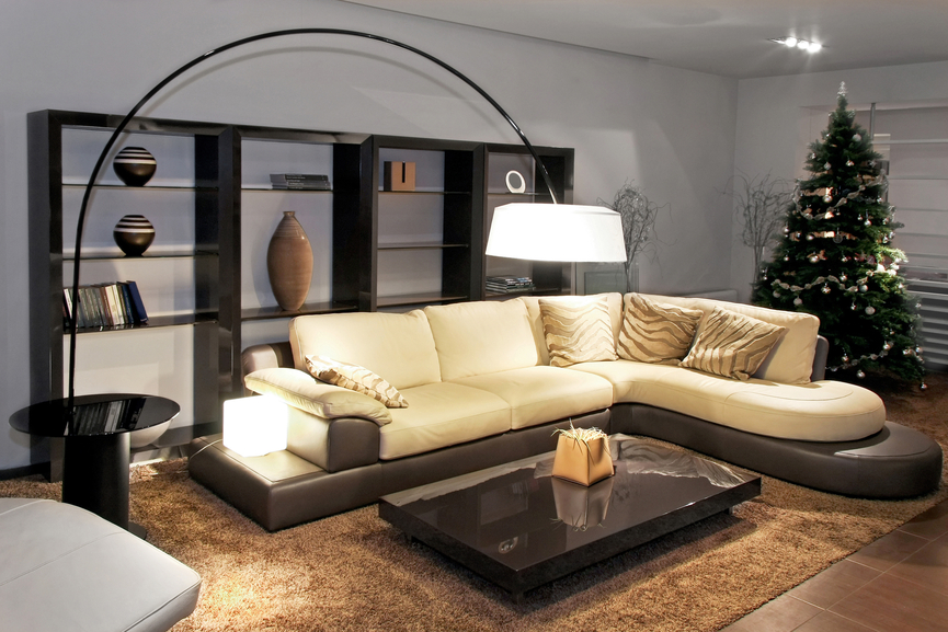 Living Room With Low Black Platform Coffee Table, Plush Beige Sofa With  Brown Base And