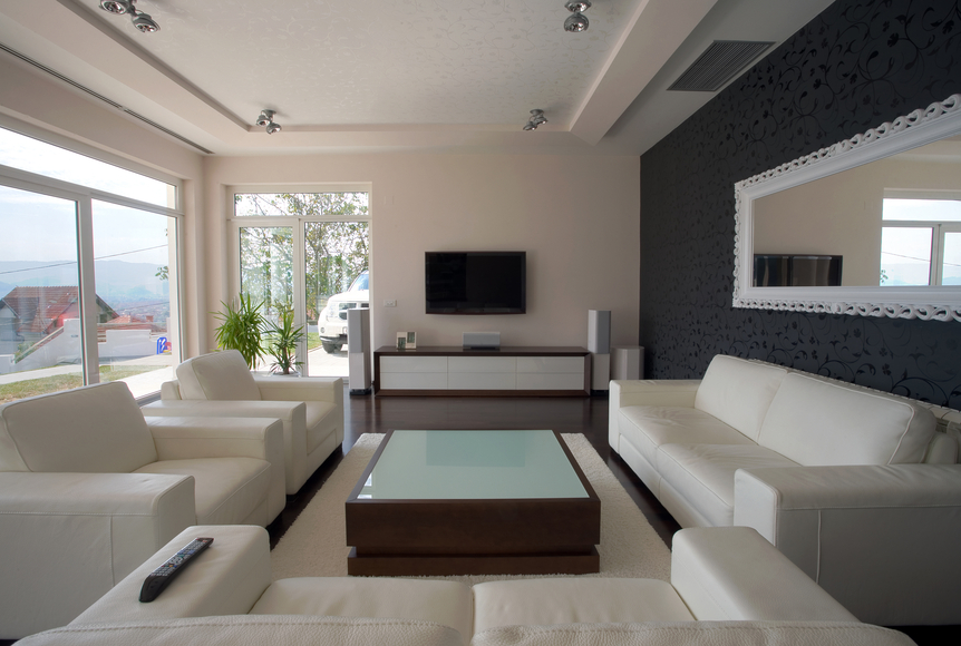 stylish contemporary living room with large white furniture dark grey and white walls and