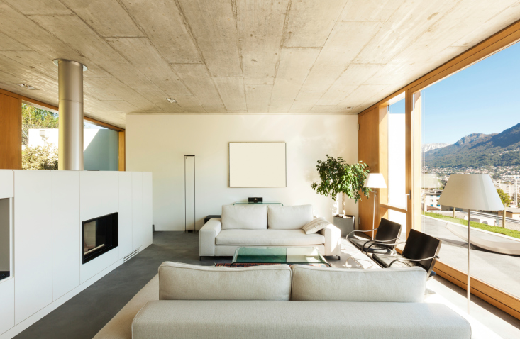 Bright living room with plush sofas and floor-to-ceiling window