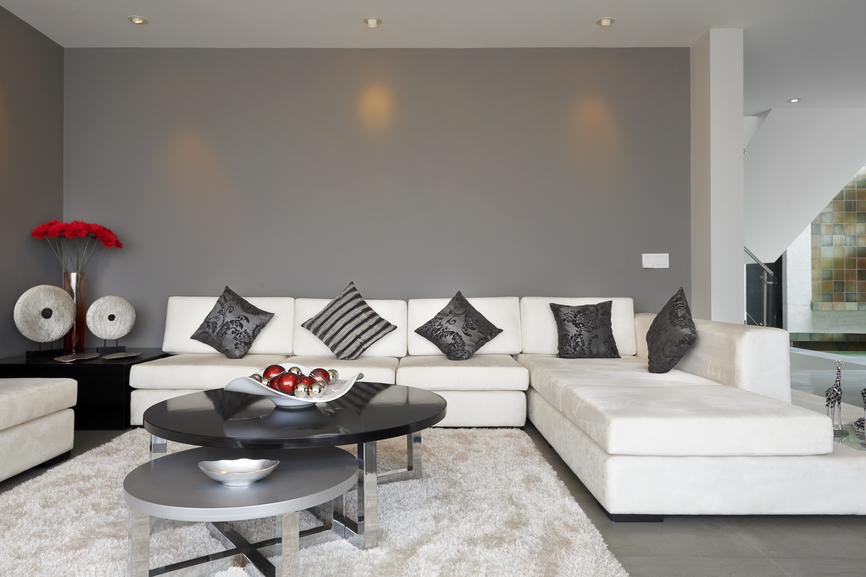 Lovely Dark Grey Living Room With White Sectional Couch And Black Coffee Table