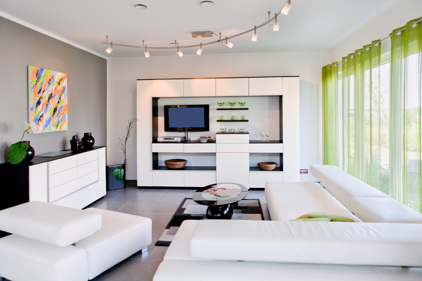 Small Modern Living Room With White Furniture And Green Drapes
