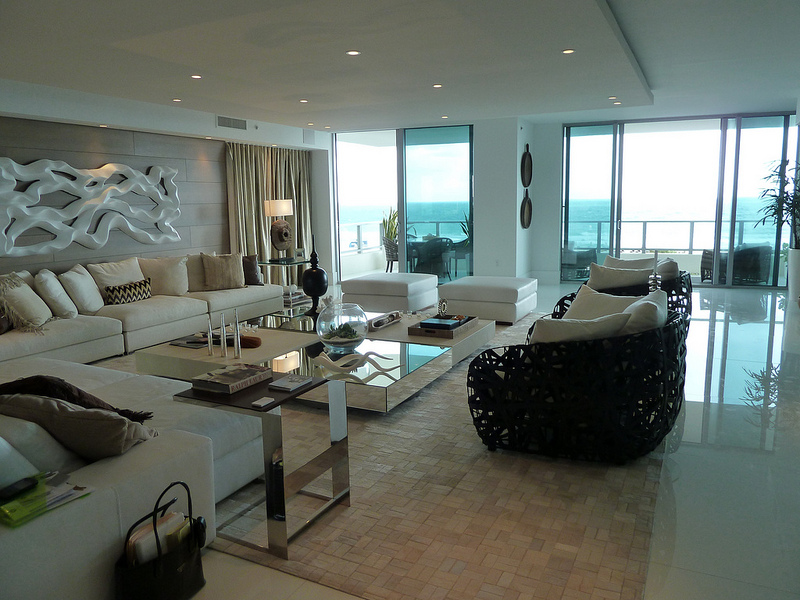 Condo living room with white and wicker furniture