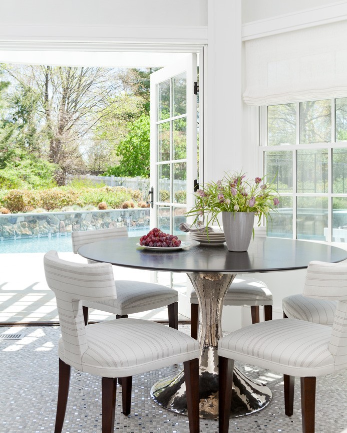 Dining Area For Four People With French Doors Opening Out Onto Backyard  Swimming Pool And Patio
