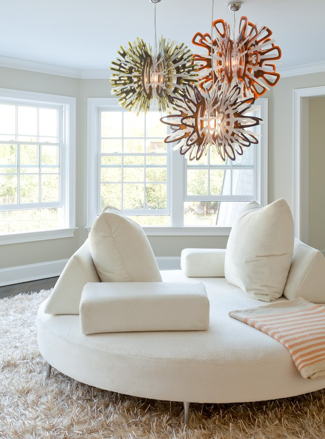 Large circular white sofa in round white room