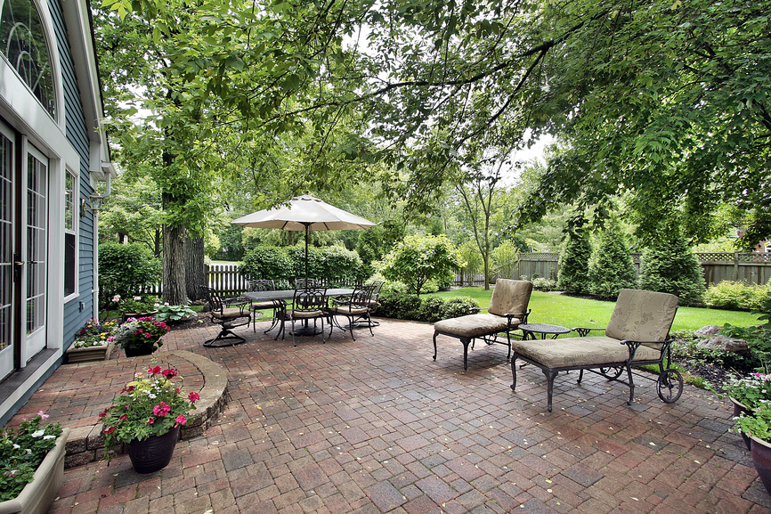 huge brick patio with lounge chairs and dining area - Outdoor Patio Design Ideas